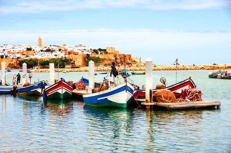 Fishing boats in Rabat, Morocco with old building at the background