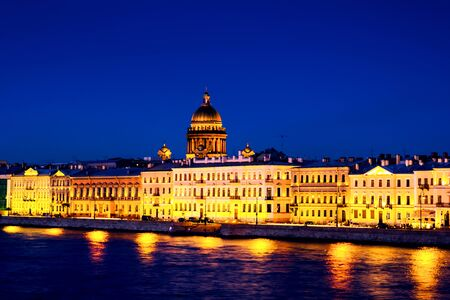 St Petersburg, Russia. Moyka river in Saint Petersburg, Russia at the night, illuminated historical buildings, bridges and clear blue sky. Various bars and restaurants Stock fotó