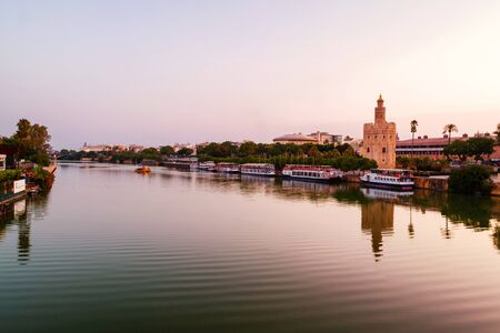 View of La Torre de Oro Tower of Gold in Seville, Spain in the morning