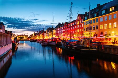 View of famous Nyhavn area in the center of Copenhagen, Denmark at night