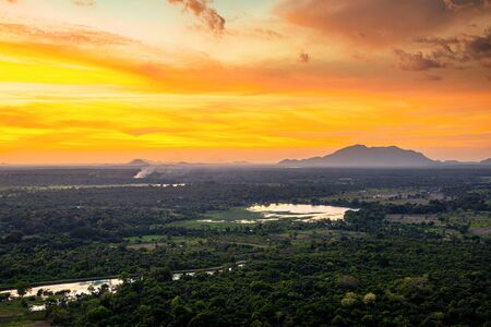 Sunset over the forest and mountains in Sigiriya, Sri Lanka