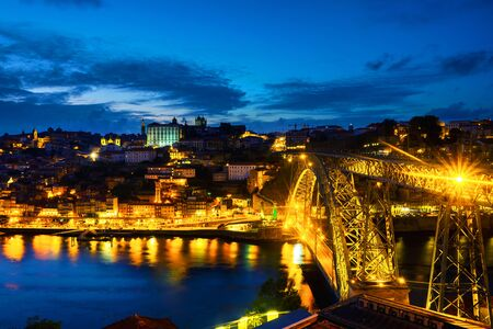 Porto, Portugal. Aerial view of Ribeira area in Porto, Portugal during a night with river, colorful buildings and bridge Stockfoto