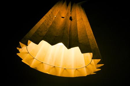 Orange and yellow map lamp on black background. Фото со стока