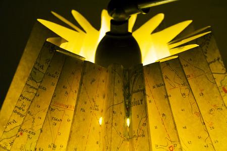 Lamp made of map with light bulb. Фото со стока