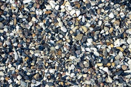 A lot of small white and dark stones. Фото со стока