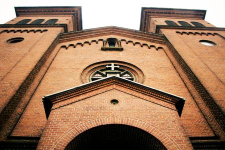 Big church with red bricks in autumn. Фото со стока