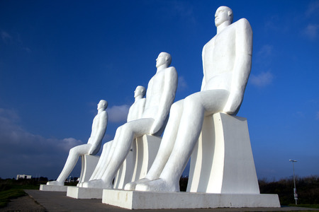 ESBJERG - NOVEMBER 9 2017: The Men at Sea is a monument of four 9 meter tall white males, located in Esbjerg, Denmark on the Beach. The sculpture was designed by Svend Wiig Hansen. Editorial