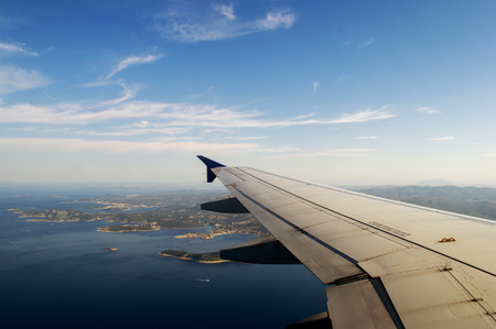 Blue sky, Croatia land and plane wing in summer on a hot day.