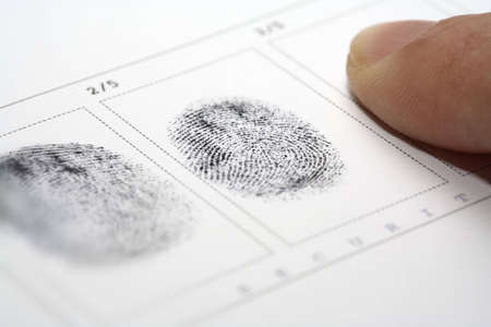 fingermark: A fingerprint on a white sheet of paper