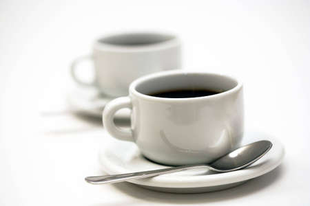 stimulate: two white cups of coffee Stock Photo