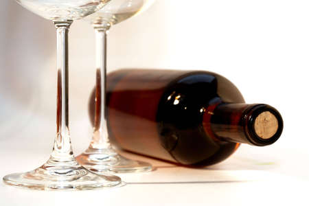 A bottle of red wine an two glasses photo