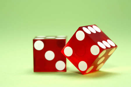 Two dice and a green background photo