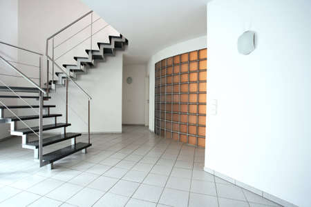 A modern room with stairs and flagstones