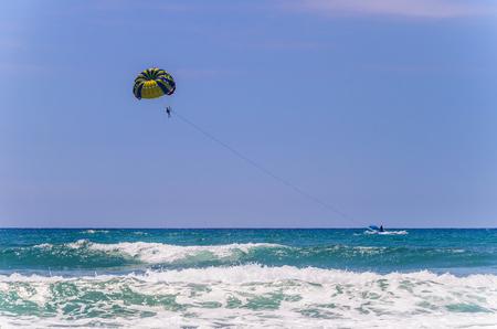 Tourists make their walk on the mountainous beaches in parachute. Stock Photo
