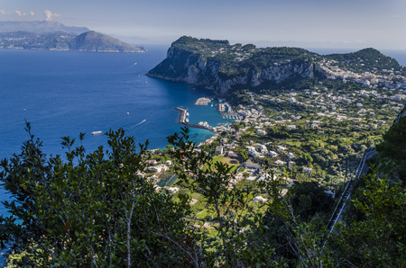 From the island you can see its port and in the distance the Italian coasts at the height of Naples Stock Photo