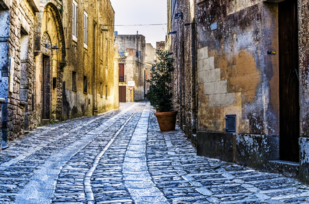 erice: Drawing in cobblestones in the streets of the city of erice