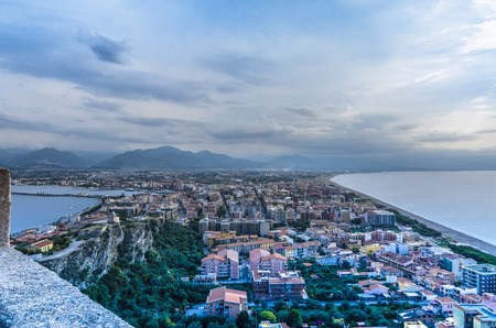 View of the city of milazzo isthmus and mountains background sicily Stock Photo