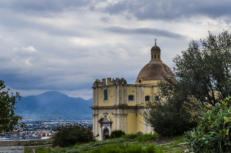 Baroque church the city of milazzo in the environs of its port and the landscape of the Sicilian territory with its mountains Stock Photo