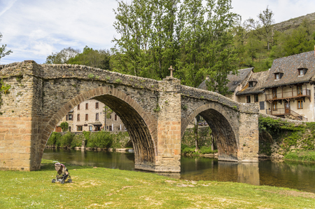 Bridge over the river Aveyron that gives name to the department in the French region of midi pyrenees at the height of the medieval village of Belcastel cataloged as one of the most beautiful villas in France.