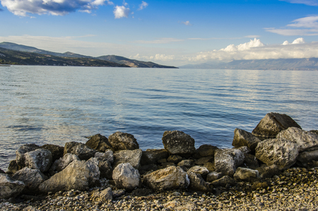 beach with volcanic rocks and coasts of the Ionian sea on the island of zakynthos Stock Photo