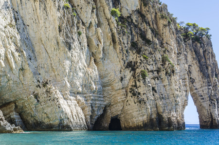 reefs caves and openings pierced by the clear waters of the Ionian sea on the coast of the island of zakynthos