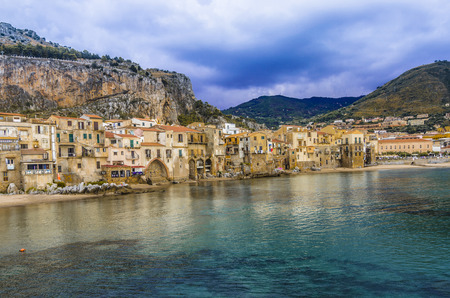 Panoramic view of the Sicilian coast in the city of Cefalu its traditional houses and the mountains that surround it a few kilometers from the city of Palermo