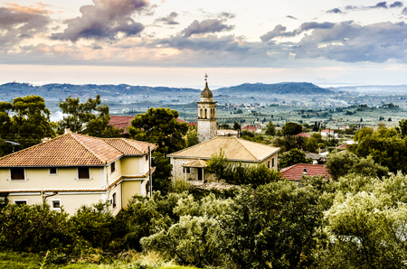 panoramic view of a sunset on the island of zakynthos with old bell tower of an orthodox church Stock Photo