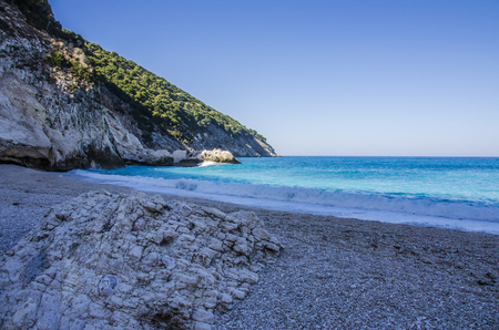 On the beach of Myrtos in Kefalonia we see formations of calcareous stones molded by the force of the sea to transform them into dust Stock Photo