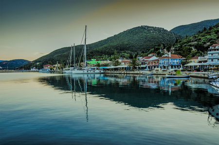 Panoramic view of the port of Sami with the boats moored in the docks the buildings of the port and in the background the mountains of the island of Kefalonia on the Ionian Sea Greece