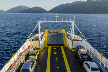 Prow of the ferry transporting cars by the Ionian sea from Sami Kefalonia towards Ithaka from which you can see the mountains in front in the vicinity of the port of Pisaetos