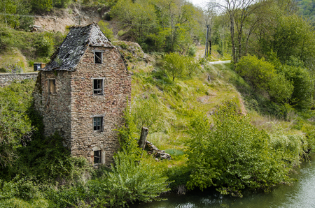 Old house in ruins on the banks of the river Aveyron and close to the medieval village of Belcastel France