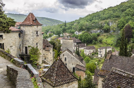 department of Lot region of midi-pyrenees are the houses of the village Saint Cirq Lapopie and the surrounding nature