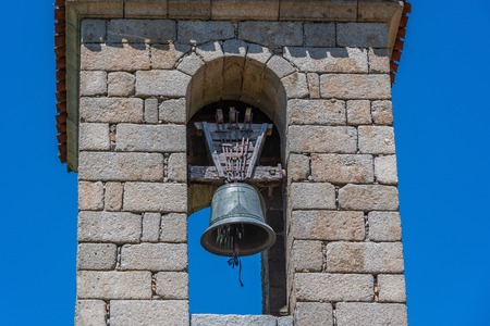 Detail of ancient bell tower of the church of Villa Vicolozano in the community of Castilla la Mancha in the vicinity of the city of Avila. Spain