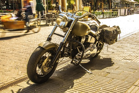 old and powerful vintage motorcycle with backpacks on a street in the old city of Breda. Netherlands Netherlands Editorial