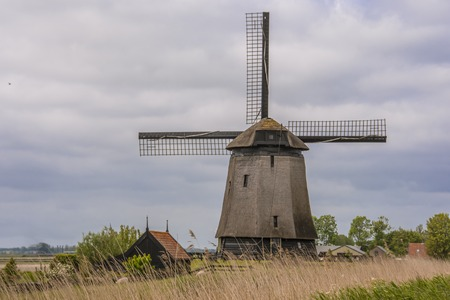 landscape with windmill and barn in the dutch countryside. Oterleek netherlands holland