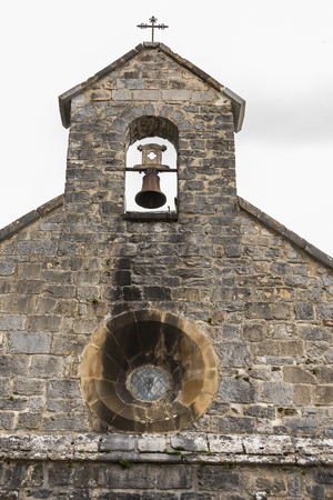 detail bell tower of the old church of Santiago in Roncesvalles, obligatory stop for all the pilgrims who make the French way of Santiago. Navarre Spain.