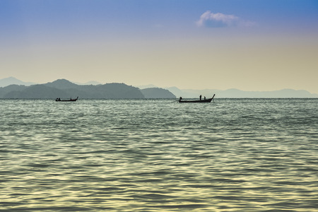 It dawns in the Phang Nga Bay and fishermen are already working on their boats in the Andaman Sea Thailand.