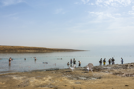 Coasts of the Dead Sea where the bathers take advantage of to anoint themselves with their mud that contains healing substances for the skin. Israel