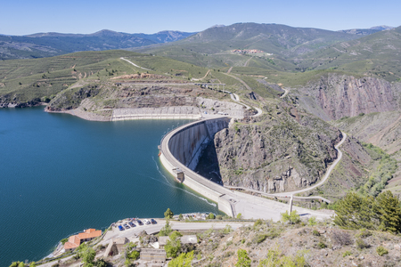 view of the Atazar dam and in the background the town of the same name. madrid Spain