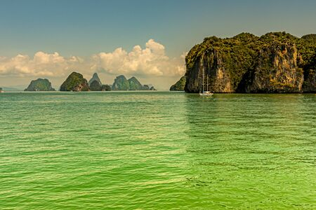 Islands of calcareous rock blocks with lush vegetation populate the waters of the Andaman Sea in Phang Nga Bay.Thailand