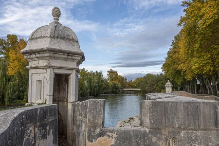 Old walls bordering the gardens of Aranjuez on the Tagus River. Madrid's community. Spain