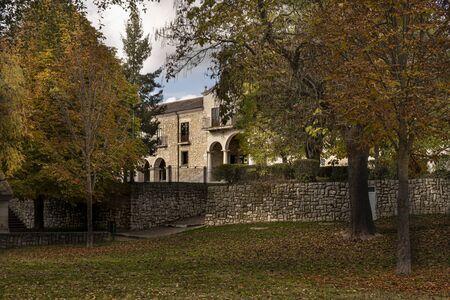 gardens one autumn day and building of the sanctuary of the virgin of the henar near the city of collar. Province of Segovia Castilla la Mancha community. Spain Фото со стока - 134414529