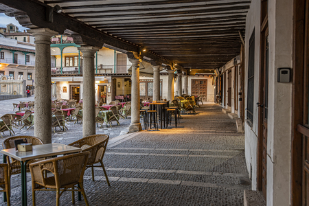 Gallery view and arcades with restaurants in the main square of the old town of Chinchon. chinchon Madrid's community. Spain Editorial