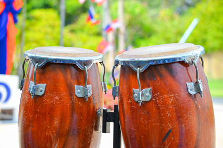 Close up image of wooden ethnic drums on green background in the intramural sports