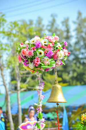 A golden bell under  artificial flowers in the intramural sports