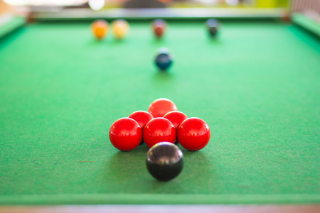 snooker balls: Closed up of red snooker ball with many snooker balls background