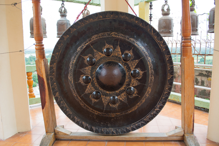 gong: Thai native Gong isolated on bells background.