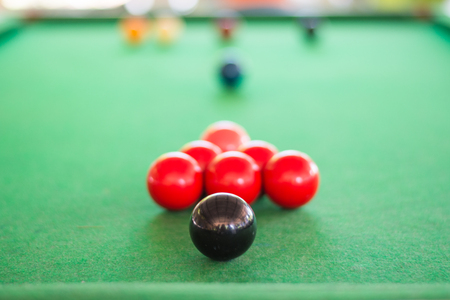 snooker balls: Closed up of black snooker ball with many snooker balls background
