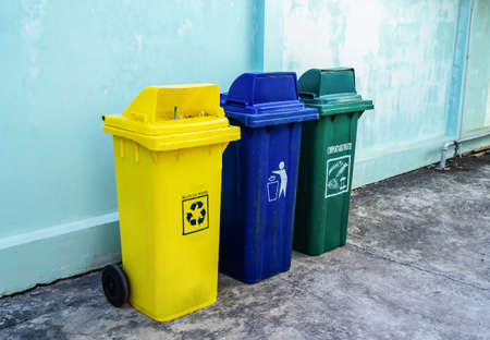 Three types of recycling bins for each type of waste. Conserve the environment. Separate buckets for plastic, paper, glass, Eco-friendly lifestyle to protect the environment.
