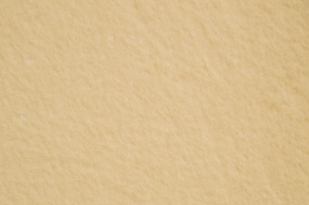 beige: gleaming beige wall background light Stock Photo